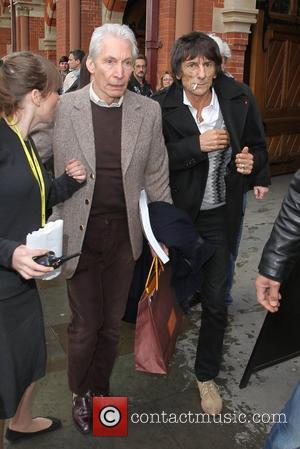 Charlie Watts and Ronnie Wood The Rolling Stones arrive at Kings Cross Station without frontman Mick Jagger London, England -...
