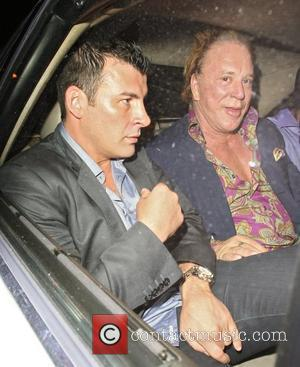 Joe Calzaghe and Mickey Rourke  leaving Rose Nightclub. The group went on to Stringfellow's where they avoided photographers by...