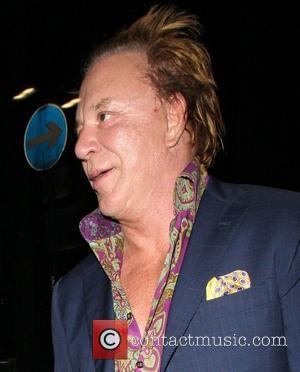 Mickey Rourke  leaving Rose Nightclub. The group went on to Stringfellow's where they avoided photographers by entering through the...