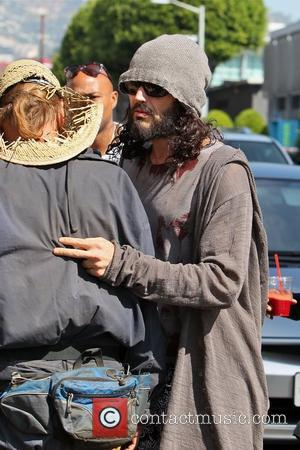 Russell Brand takes a group of homeless friends out to breakfast at the Newsroom Cafe in Hollywood Los Angeles, California...