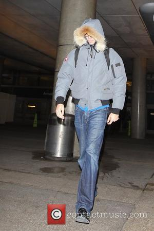 Sacha Baron Cohen  seen arriving at LAX international airport after catching a flight from the UK.He uses his coat...