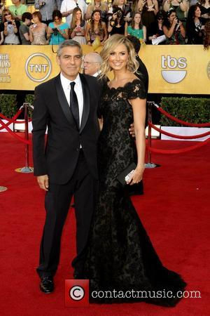 George Clooney and Stacey Keibler,  at the 18th Annual Screen Actors Guild Awards (SAG Awards) held at The Shrine...