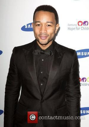 John Legend Runs With Olympic Torch