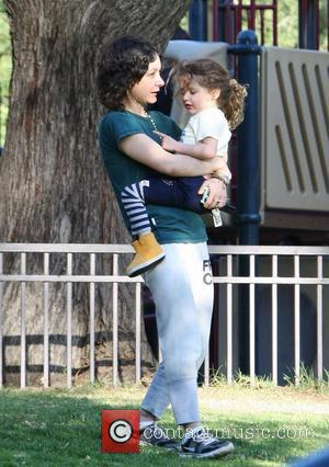 Sara Gilbert playing with her daughter Sawyer at a park in Beverly Hills Los Angeles, California - 10.02.12