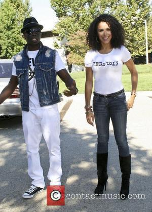 Brittany Bell and Sam Sarpong Supermodel Sam Sarpong and Miss Arizona USA 2010 Brittany Bell on a fashion shoot for...