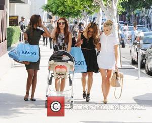 Rochelle Wiseman, Vanessa White, Mollie King and Una Healy (with her daughter Aoife Belle) of The Saturdays  The Saturdays...