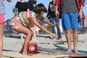 Frankie Sandford of The Saturdays takes surfing lessons on Venice Beach Los Angeles, California - 10.10.12