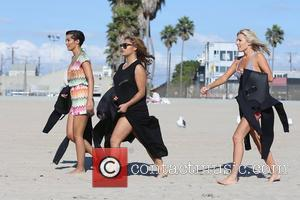 Frankie Sandford, Vanessa White and Mollie King of The Saturdays take surfing lessons on Venice Beach Los Angeles, California -...