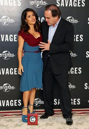Hands Off! Salma Hayek Wows Oliver Stone At 'Savages' Photo-call