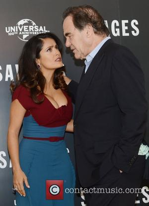 Oliver Stone and Salma Hayek at a photocall for Savages at the Mandarin Oriental, London, England- 19.09.12