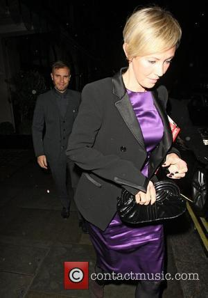 Gary Barlow and Dawn Barlow leaving Scotts restaurant after dining with David Walliams and Lara Stone, Dawn was carrying two...
