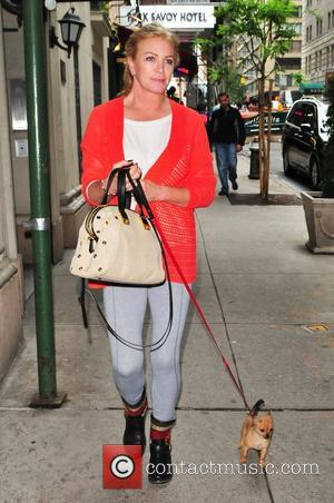 Shannon Tweed walking her new puppy in Midtown New York City, USA - 22.05.12