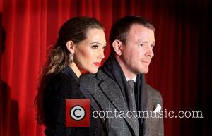 Guy Ritchie and girlfriend Jacqui Ainsley 'Sherlock Holmes: A Game of Shadow' premiere - Arrivals London, England - 08.12.11