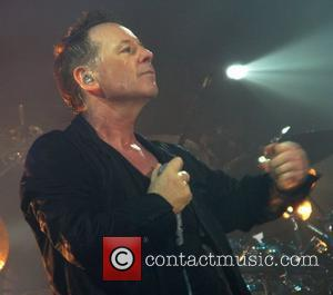 Jim Kerr Simple Minds performing at The Roundhouse London, England - 02.03.12