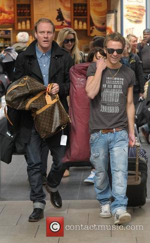 Antony Cotton and Jack P Shepherd board a train at Manchester Piccadilly train station on the way to attending the...