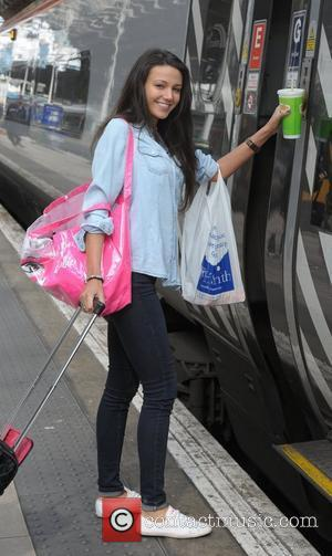 Michelle Keegan minus her engagement ring, boards a train at Manchester Piccadilly train station on the way to attending the...