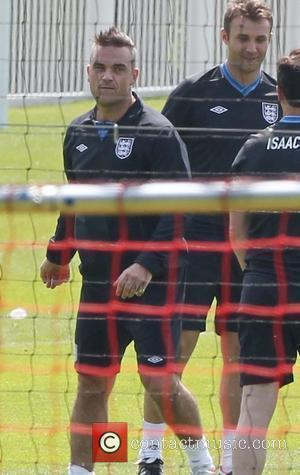 Robbie Williams and Jason Isaacs  Training for the Soccer Aid match which will be held in Manchester's Old Trafford...
