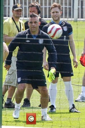 Robbie Williams and Olly Murs Training for the Soccer Aid match which will be held in Manchester's Old Trafford stadium...