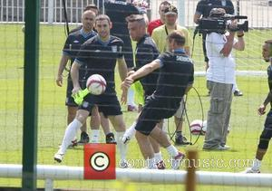 Robbie Williams and Teddy Sheringham Training for the Soccer Aid match which will be held in Manchester's Old Trafford stadium...