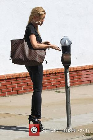Sophie Monk feeding a parking meter outside The King's Road Cafe in West Hollywood Los Angeles, California - 16.05.12