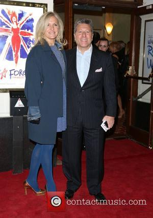 Neil Fox with his wife Vicky VIVA Forever Spice Girls the Musical held at the Piccadilly Theatre- Arrivals London, England...