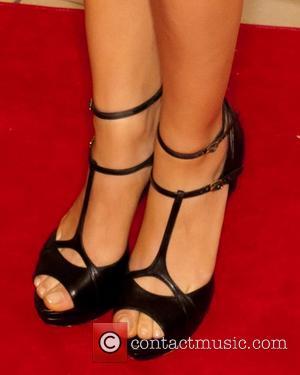 Mila Kunis and Beverly Hilton Hotel