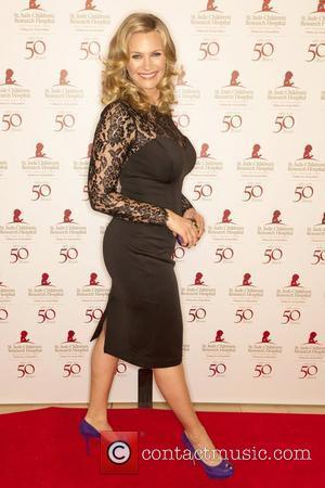Natasha Henstridge and Beverly Hilton Hotel