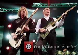 Rick Parfitt and Francis Rossi of Status Quo performing at Liverpool Echo Arena. Liverpool, England - 06.12.11