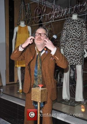 Vic Reeves Stella McCartney store lights switch held on Bruton Street. London, England - 10.12.12