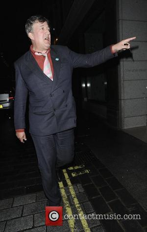 Stephen Fry walking in Mayfair London, England - 21.06.12