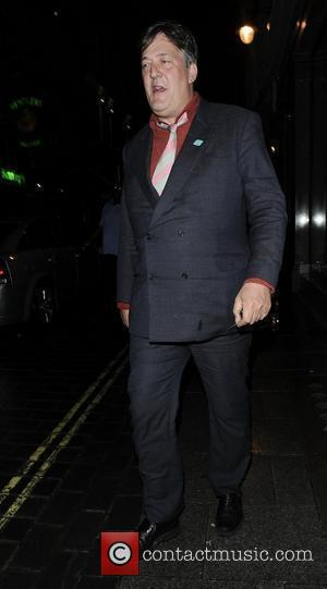 Stephen Fry walking in Mayfair London, England - 21.06.12