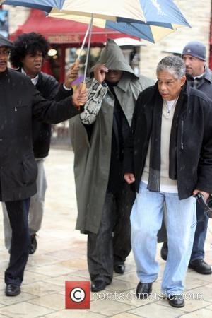 Stevie Wonder braves the rain to film an appearance on the entertainment news show 'Extra' at The Grove  Los...