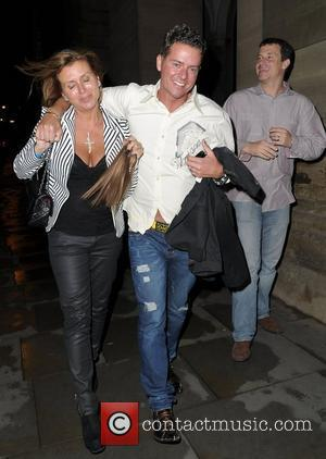 Tricia Penrose with Mark Simpkinlooking worse for wear carrying her hair extensions World premiere of 'Street of Dreams Musical' afterparty...