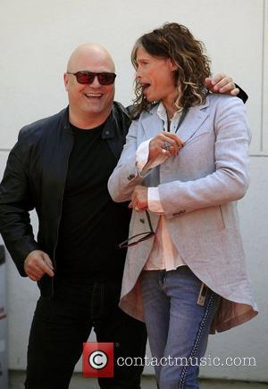 Michael Chiklis and Steven Tyler