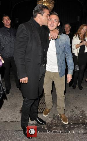 Tamer Hassan and Kirk Norcross Kirk getting kissed by Tamer outside Sugar Hut. Brentwood, Essex - 4.05.12