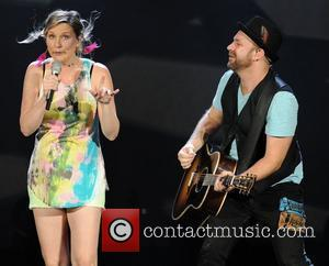 Jennifer Nettles and Kristian Bush of Sugarland  performing during the 'In Your Hands' Tour at the Cruzan Amphitheatre West...