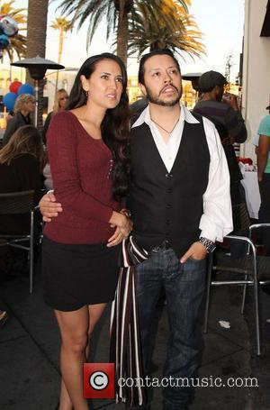 Burgandi Phoenix and Carlos Ramirez,  at the Super Bowl Party at Sangria tapas bar. Hermosa Beach, California - 05.02.12
