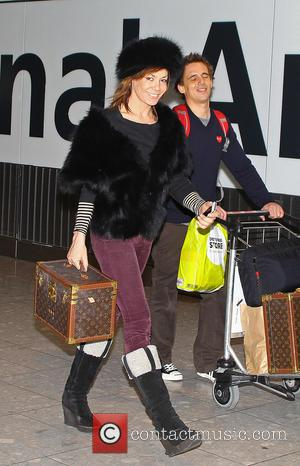 Tara Palmer-Tomkinson arrives at Heathrow Airport with personalized Louis Vuitton luggage  Featuring: Tara Palmer-Tomkinson