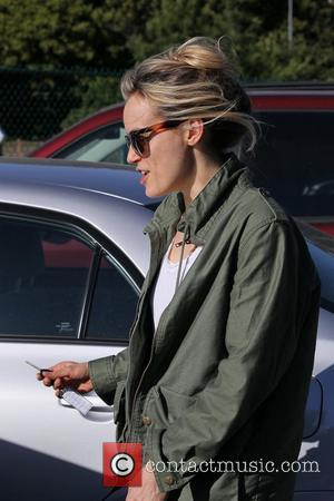 Taylor Schilling exits Byron and Tracey Salon carrying shopping bags Los Angeles, California - 07.03.12