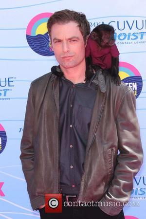 Justin Kirk and Crystal the Monkey The 2012 Teen Choice Awards held at the Gibson Amphitheatre - Arrivals Universal City,...