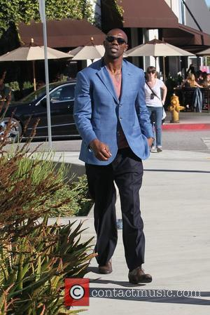 Terrell Owens departs a restaurant after having lunch with a friend Los Angeles, California - 25.01.12