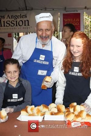 LA Council member Dennis P. Zine,  at the Los Angeles Mission's Thanksgiving for skid row homeless at the Los...