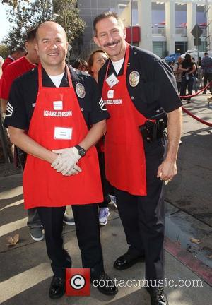 LAPD Officers Steve Sambar and Marco Lozano  ,  at the Los Angeles Mission's Thanksgiving for skid row homeless...