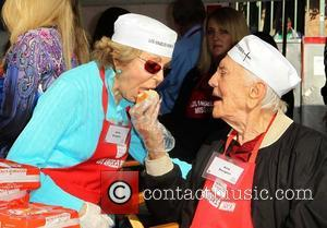 Anne Buydens Douglas, Kirk Douglas,  at the Los Angeles Mission's Thanksgiving for skid row homeless at the Los Angeles...