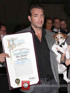 Jean Dujardin, Uggie the dog,  at the Commendation from The City of Los Angeles to 'THE ARTIST'. Hollywood, California...