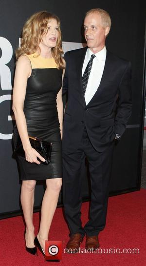 Rene Russo and Dan Gilroy,  at the Universal Pictures world premiere of 'The Bourne Legacy' at the Ziegfeld Theatre...