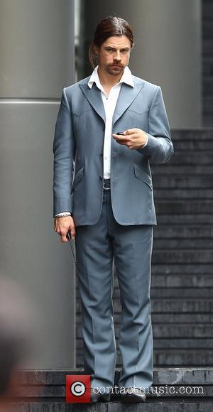 Brad Pitt's stunt double filming a scene of the movie 'The Counselor' on location in London. The story is about...