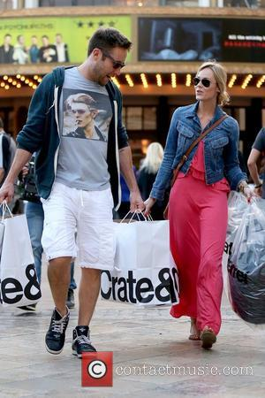 Actor Michael Rosenbaum has his hands full as he leaves Crate & Barrel after shopping at The Grove with his...