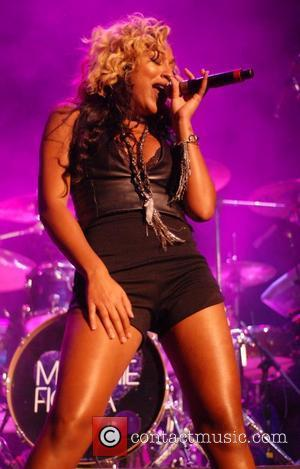 Melanie Fiona Mary J. Blige performs as part of 'The Liberation Tour' with support from D'Angelo and Melanie Fiona Chicago,...