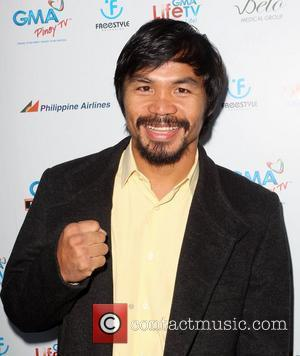 Manny Pacquiao attending a screening of Freestyle Releasing's The Road, held at The Arclight Theatre Hollywood, California - 09.05.12